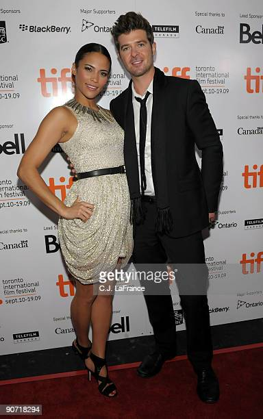 Actress Paula Patton and singer Robin Thicke arrive at the 'Precious Based on the Novel 'Push' by Sapphire' screening introduction during the 2009...