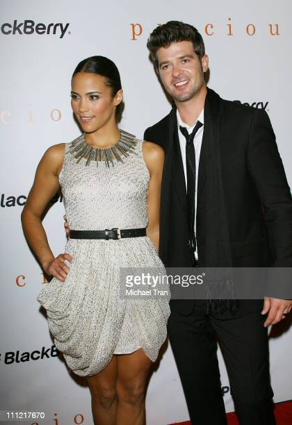 Actress Paula Patton and singer Robin Thicke arrive to the 'Precious' PreGala cocktail party hosted by Lionsgate and Blackberry held at Royal Ontario...