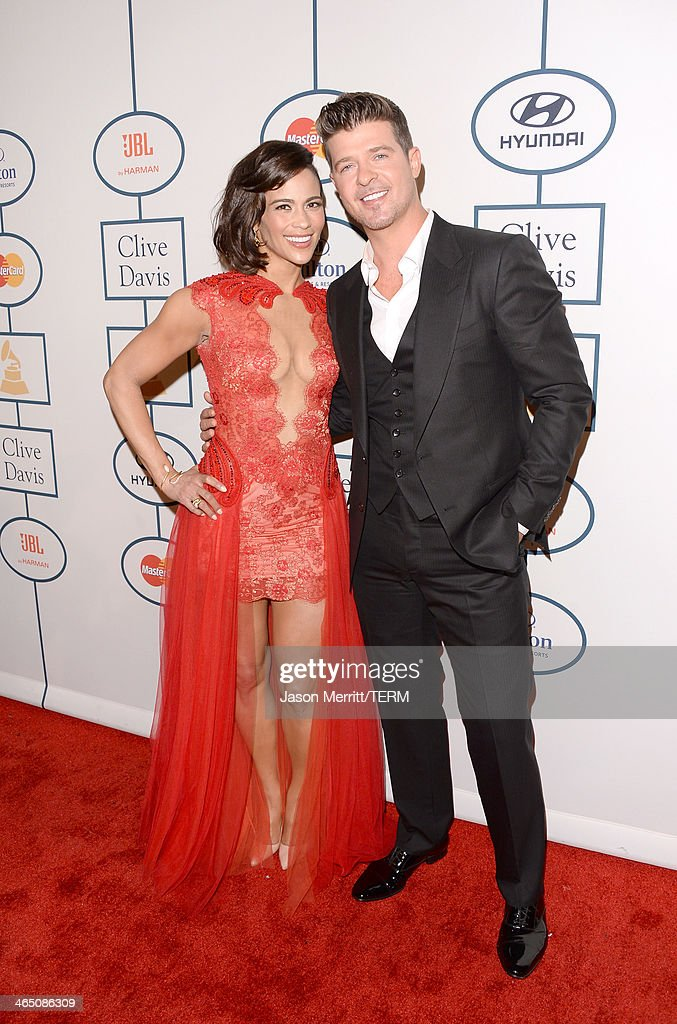 Actress Paula Patton and singer Robin Thicke attend the 56th annual GRAMMY Awards Pre-GRAMMY Gala and Salute to Industry Icons honoring Lucian Grainge at The Beverly Hilton on January 25, 2014 in Los Angeles, California.