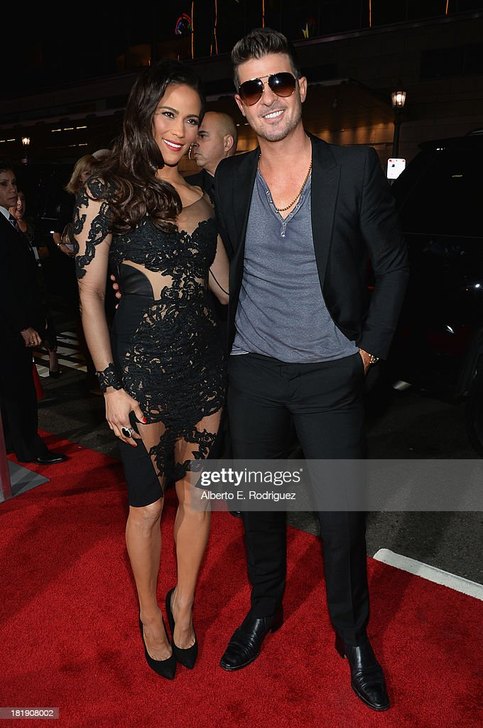 Actress Paula Patton and singer Robin Thicke attend the premiere of Fox Searchlight Pictures' 'Baggage Claim' at Regal Cinemas L.A. Live on September 25, 2013 in Los Angeles, California.