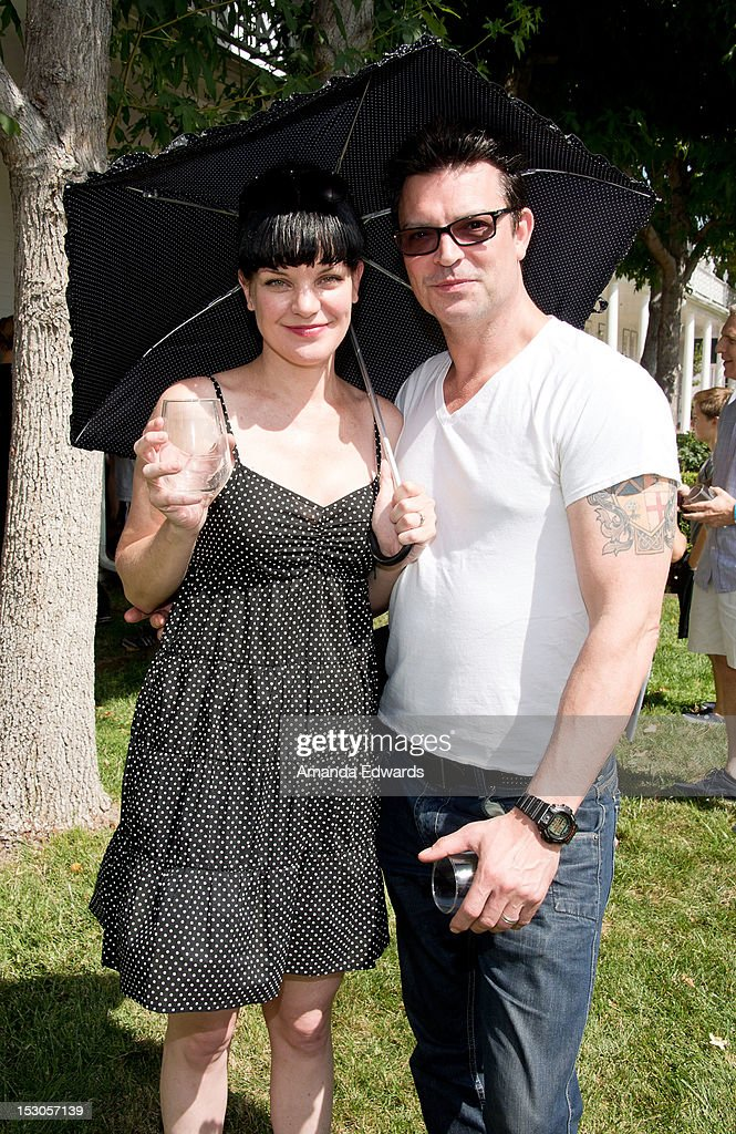 Actress Pauley Perrette (L) and her husband Michael Bosman arrive at the L.A. Loves Alex's Lemonade Culinary Event at Culver Studios on September 29, 2012 in Culver City, California.