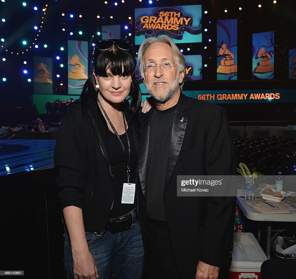 Actress Pauley Perrette (L) and Recording Academy President/CEO Neil Portnow attend rehearsals for the 56th GRAMMY Awards on January 25, 2014 in Los Angeles, California.