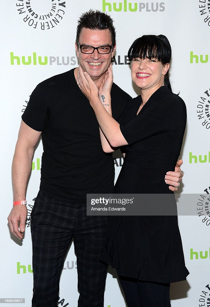 Actress <a gi-track='captionPersonalityLinkClicked' href=/galleries/search?phrase=Pauley+Perrette&family=editorial&specificpeople=625846 ng-click='$event.stopPropagation()'>Pauley Perrette</a> (R) and Thomas Arklie arrive at the 30th Annual PaleyFest: The William S. Paley Television Festival featuring 'The Big Bang Theory' at the Saban Theatre on March 13, 2013 in Beverly Hills, California.
