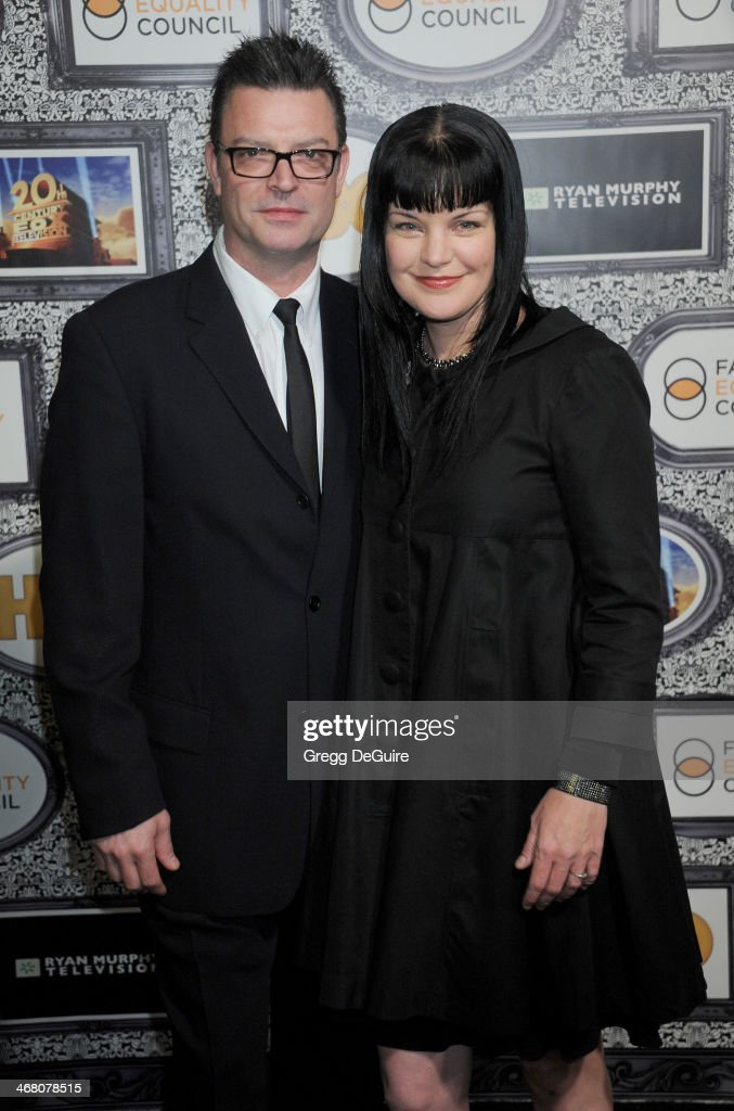 Actress <a gi-track='captionPersonalityLinkClicked' href=/galleries/search?phrase=Pauley+Perrette&family=editorial&specificpeople=625846 ng-click='$event.stopPropagation()'>Pauley Perrette</a> and Thomas Arklie arrive at the Family Equality Council's Annual Los Angeles Awards Dinner at The Globe Theatre on February 8, 2014 in Universal City, California.
