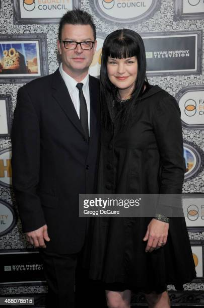 Actress Pauley Perrette and Thomas Arklie arrive at the Family Equality Council's Annual Los Angeles Awards Dinner at The Globe Theatre on February 8...