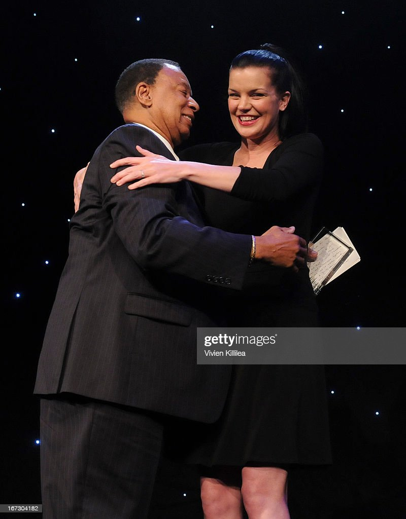 Actress Pauley Perrette presents producer Charles F. Johnson with the Creative Vision Award during Liberty Hill's Upton Sinclair Awards Dinner Honors - Show at The Beverly Hilton Hotel on April 23, 2013 in Beverly Hills, California.