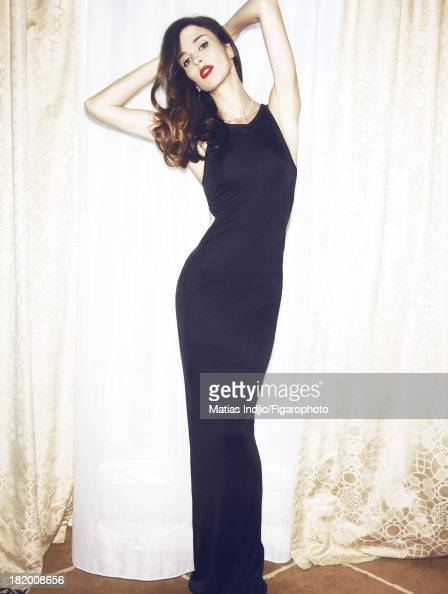 106860010 Actress Paz Vega is photographed for Madame Figaro on May 28 2013 in Cannes France Dress earrings and necklace from Seven Stars collection...