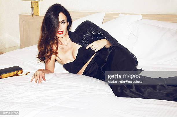 106860009 Actress Paz Vega is photographed for Madame Figaro on May 28 2013 in Cannes France Jacket and pants bra Princesse Grace de Monaco ring...