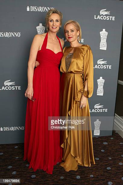 Actress Penelope Ann Miller and host Jane Lynch attend the 14th Annual Costume Designers Guild Awards With Presenting Sponsor Lacoste held at The...