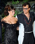 Actress Penelope Cruz and actor Johnny Depp arrive at premiere of Walt Disney Pictures' 'Pirates of the Caribbean On Stranger Tides' held at...