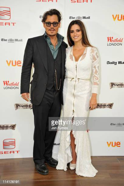 Actress Penelope Cruz and actor Johnny Depp arrive for the UK Premiere of 'Pirates Of The Caribbean On Stranger Tides' at Vue Westfield on May 12...