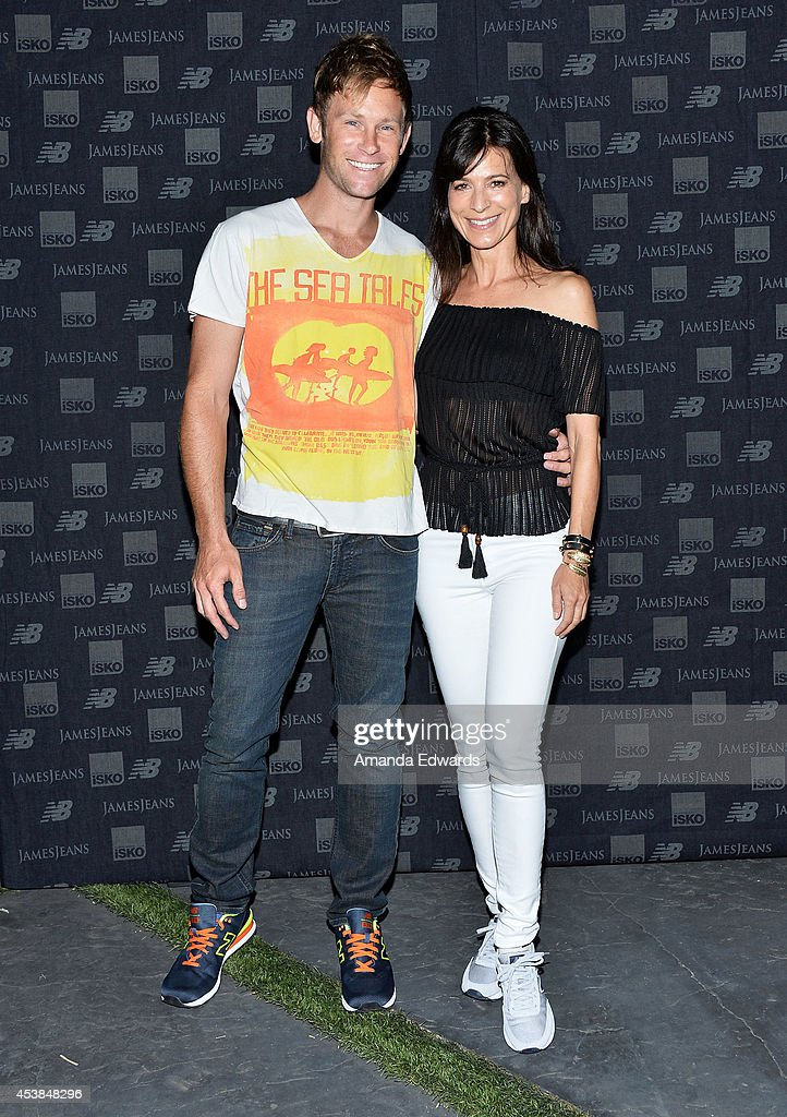 Actress <a gi-track='captionPersonalityLinkClicked' href=/galleries/search?phrase=Perrey+Reeves&family=editorial&specificpeople=537738 ng-click='$event.stopPropagation()'>Perrey Reeves</a> (R) and Aaron Fox arrive at a dance party with New Balance and James Jeans powered by ISKO at a private residence on August 19, 2014 in Beverly Hills, California.