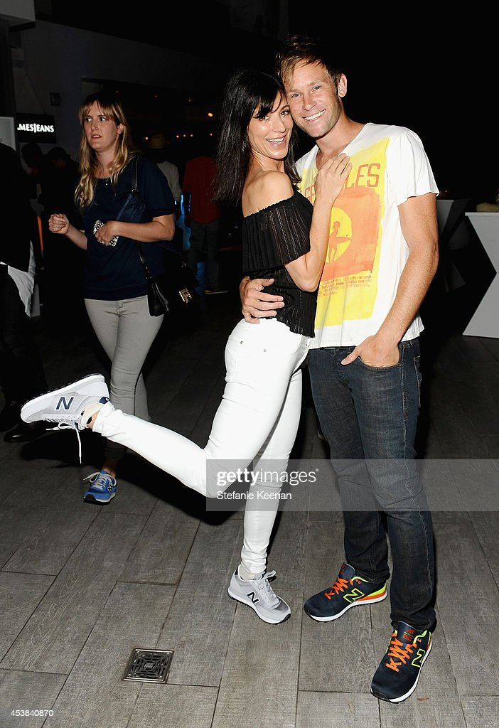 Actress Perrey Reeves and Aaron Fox attend a dance party with New Balance and James Jeans powered by ISKO at the home of Pascal Mouawad on August 19, 2014 in Bel Air, California.