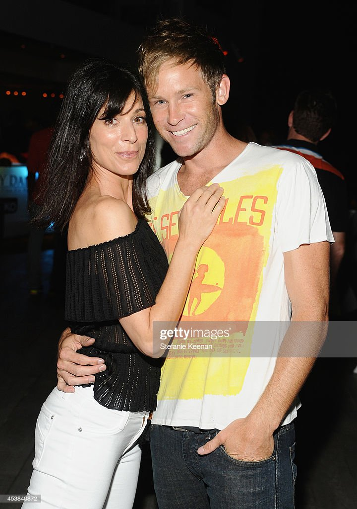 Actress <a gi-track='captionPersonalityLinkClicked' href=/galleries/search?phrase=Perrey+Reeves&family=editorial&specificpeople=537738 ng-click='$event.stopPropagation()'>Perrey Reeves</a> and Aaron Fox attend a dance party with New Balance and James Jeans powered by ISKO at the home of Pascal Mouawad on August 19, 2014 in Bel Air, California.