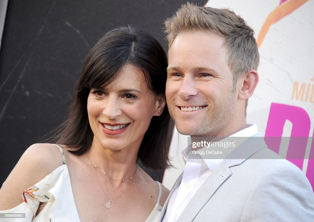 Actress Perrey Reeves and husband Aaron EndressFox arrive at the premiere of Warner Bros Pictures' 'War Dogs' at TCL Chinese Theatre on August 15...