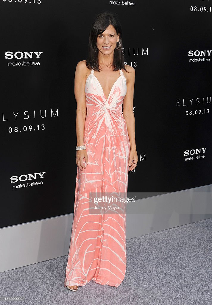 Actress Perrey Reeves arrives at the Los Angeles premiere of 'Elysium' at Regency Village Theatre on August 7, 2013 in Westwood, California.