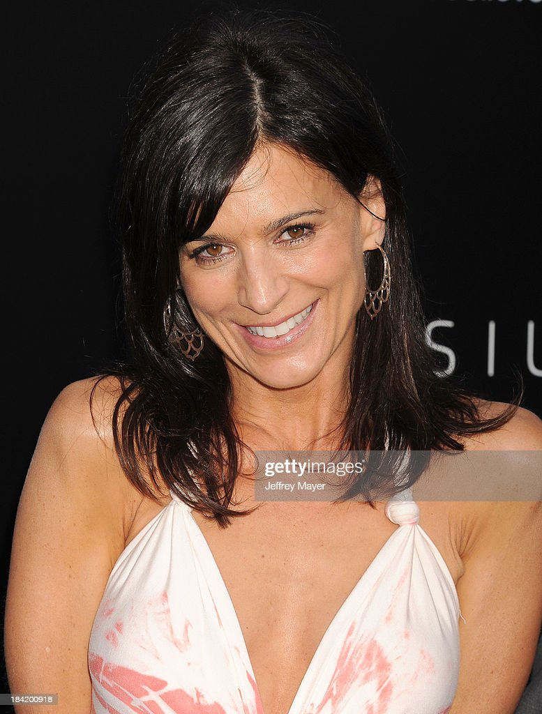 Actress <a gi-track='captionPersonalityLinkClicked' href=/galleries/search?phrase=Perrey+Reeves&family=editorial&specificpeople=537738 ng-click='$event.stopPropagation()'>Perrey Reeves</a> arrives at the Los Angeles premiere of 'Elysium' at Regency Village Theatre on August 7, 2013 in Westwood, California.