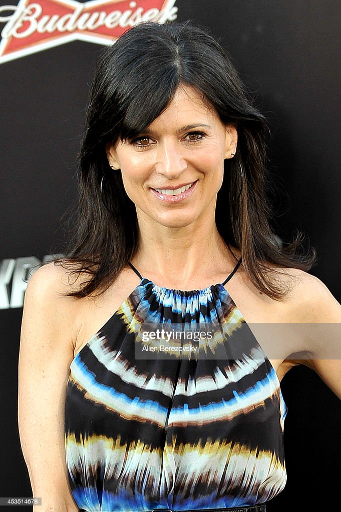 Actress Perrey Reeves arrives at the Los Angeles premiere of Lionsgate Films' 'The Expendables 3' at TCL Chinese Theatre on August 11, 2014 in Hollywood, California.