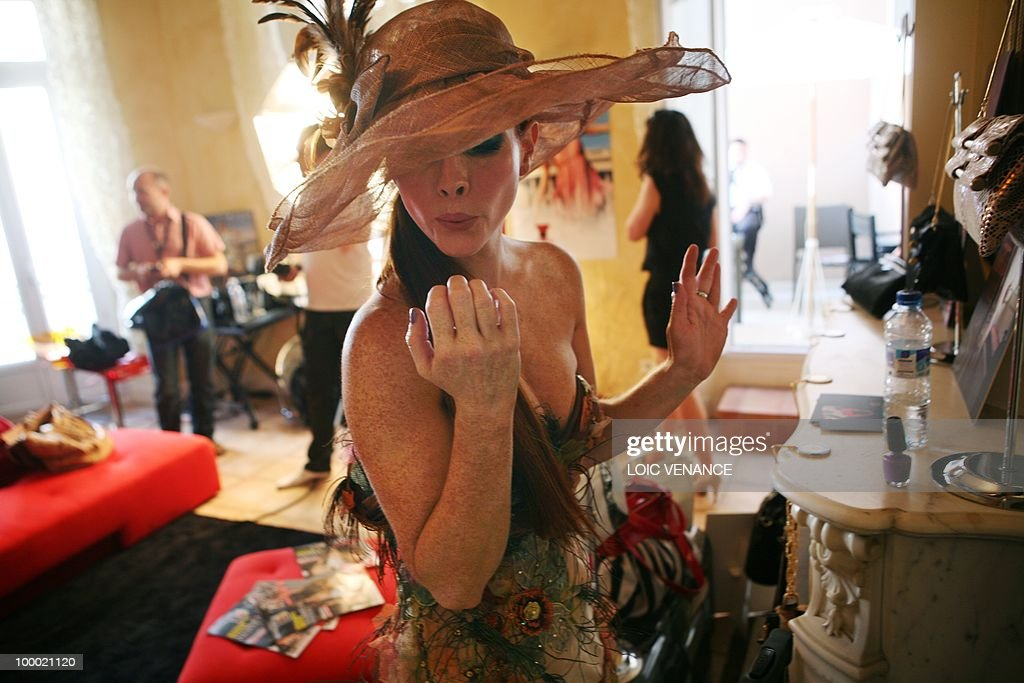 US actress Phoebe Price dries her nails after putting on some nail polish as she prepares in the show room of Christophe Guillarme French designer during the 63rd Cannes Film Festival on May 20, 2010 in Cannes.
