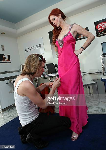 Actress Phoebe Price models Christophe Guillarme's 2007 collection between interviews for Fashion TV MTV and Gala Magazine at designer Christophe...