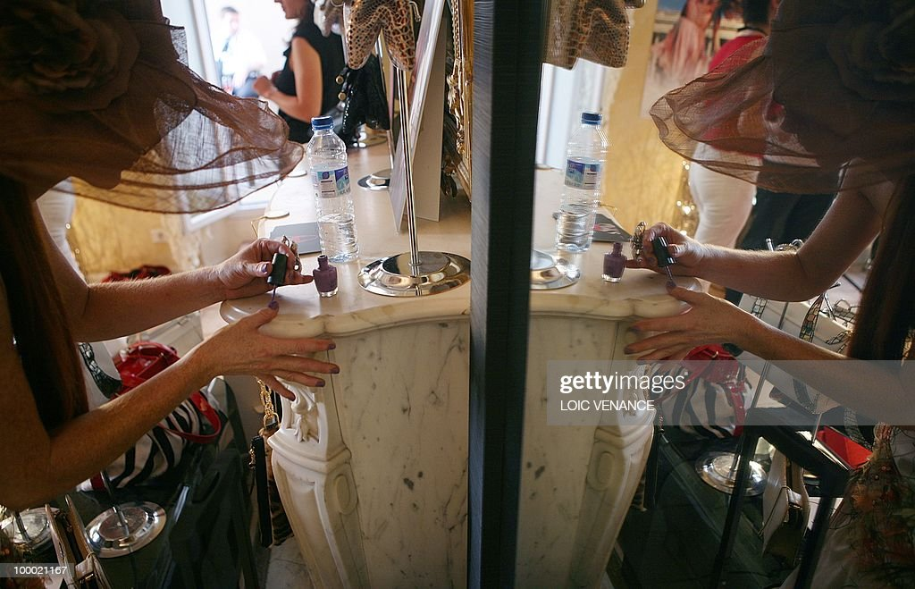 US actress Phoebe Price puts some nail polish as she prepares in the show room of Christophe Guillarme French designer during the 63rd Cannes Film Festival on May 20, 2010 in Cannes.