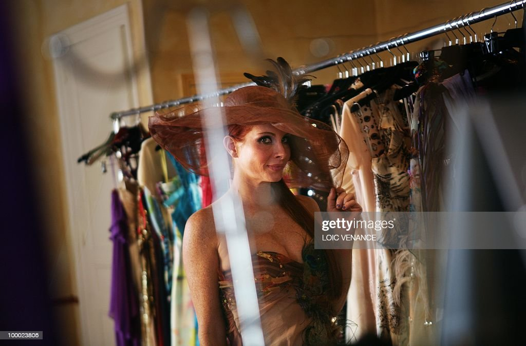 US actress Phoebe Price tries clothes designed by French Christophe Guillarme as she prepares to walk on the red carpet at the 63rd Cannes Film Festival on May 20, 2010 in Cannes.