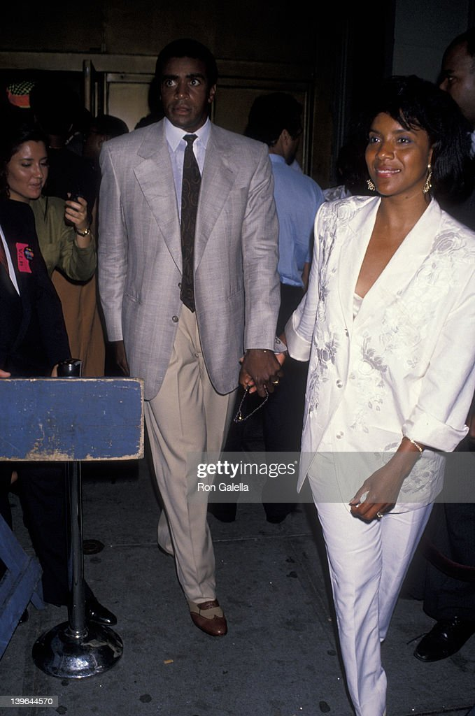 Actress <a gi-track='captionPersonalityLinkClicked' href=/galleries/search?phrase=Phylicia+Rashad&family=editorial&specificpeople=206924 ng-click='$event.stopPropagation()'>Phylicia Rashad</a> and sportscaster <a gi-track='captionPersonalityLinkClicked' href=/galleries/search?phrase=Ahmad+Rashad&family=editorial&specificpeople=228301 ng-click='$event.stopPropagation()'>Ahmad Rashad</a> attending the premiere of 'Mo' Better Blues' on July 23, 1990 at the Ziegfeld Theater in New York City, New York.