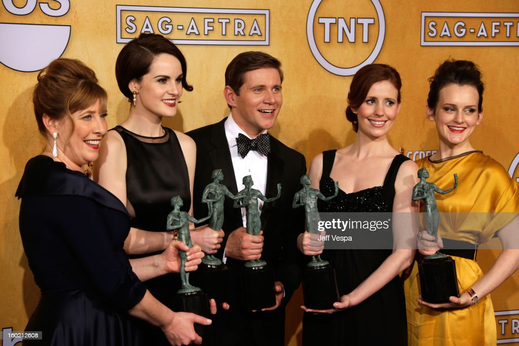 Actress Phyllis Logan, actress Michelle Dockery, actpr Allen Leech, actress Amy Nutall and actress Sophie McSheara pose in the press room during the 19th Annual Screen Actors Guild Awards held at The Shrine Auditorium on January 27, 2013 in Los Angeles, California.