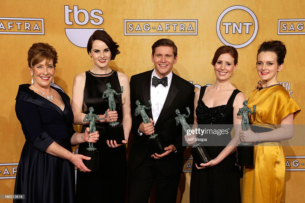 Actress <a gi-track='captionPersonalityLinkClicked' href=/galleries/search?phrase=Phyllis+Logan&family=editorial&specificpeople=540316 ng-click='$event.stopPropagation()'>Phyllis Logan</a>, actress <a gi-track='captionPersonalityLinkClicked' href=/galleries/search?phrase=Michelle+Dockery&family=editorial&specificpeople=4047702 ng-click='$event.stopPropagation()'>Michelle Dockery</a>, actpr <a gi-track='captionPersonalityLinkClicked' href=/galleries/search?phrase=Allen+Leech&family=editorial&specificpeople=2167022 ng-click='$event.stopPropagation()'>Allen Leech</a>, actress Amy Nutall and actress Sophie McSheara pose in the press room during the 19th Annual Screen Actors Guild Awards held at The Shrine Auditorium on January 27, 2013 in Los Angeles, California.