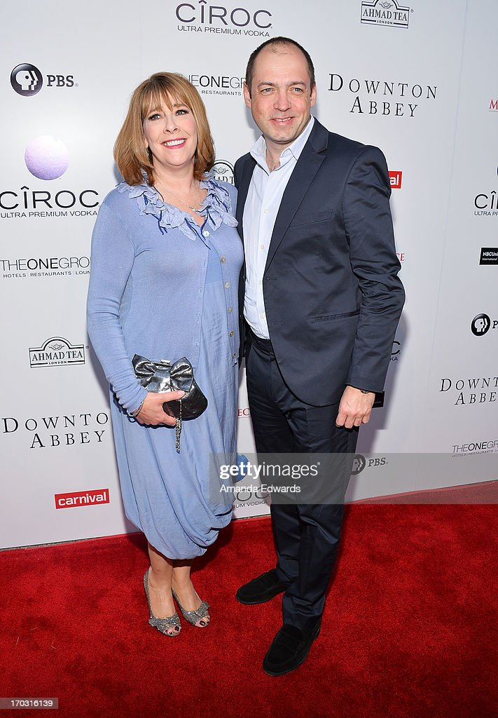 Actress <a gi-track='captionPersonalityLinkClicked' href=/galleries/search?phrase=Phyllis+Logan&family=editorial&specificpeople=540316 ng-click='$event.stopPropagation()'>Phyllis Logan</a> (L) and executive producer <a gi-track='captionPersonalityLinkClicked' href=/galleries/search?phrase=Gareth+Neame&family=editorial&specificpeople=5939160 ng-click='$event.stopPropagation()'>Gareth Neame</a> arrive at the 'Downton Abbey' talent panel Q&A at the Leonard H. Goldenson Theatre on June 10, 2013 in North Hollywood, California.