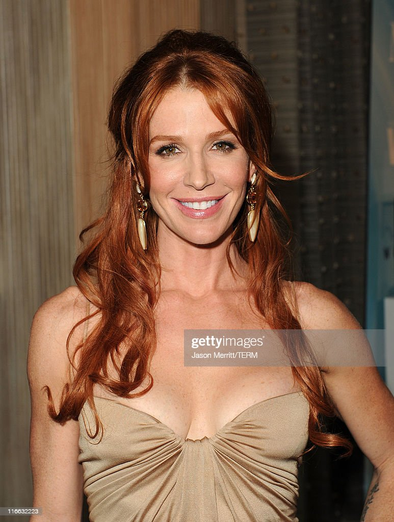 Actress <a gi-track='captionPersonalityLinkClicked' href=/galleries/search?phrase=Poppy+Montgomery&family=editorial&specificpeople=206149 ng-click='$event.stopPropagation()'>Poppy Montgomery</a> arrives at the 2011 Women In Film Crystal + Lucy Awards with presenting sponsor PANDORA jewelry at the Beverly Hilton Hotel on June 16, 2011 in Beverly Hills, California.