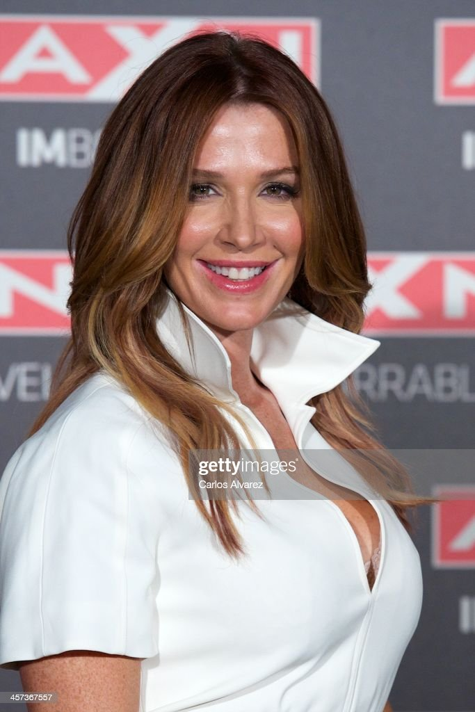 Actress <a gi-track='captionPersonalityLinkClicked' href=/galleries/search?phrase=Poppy+Montgomery&family=editorial&specificpeople=206149 ng-click='$event.stopPropagation()'>Poppy Montgomery</a> attends the 'Unforgettable' (Imborrable) photocall at the AC Retitro Hotel on December 17, 2013 in Madrid, Spain.