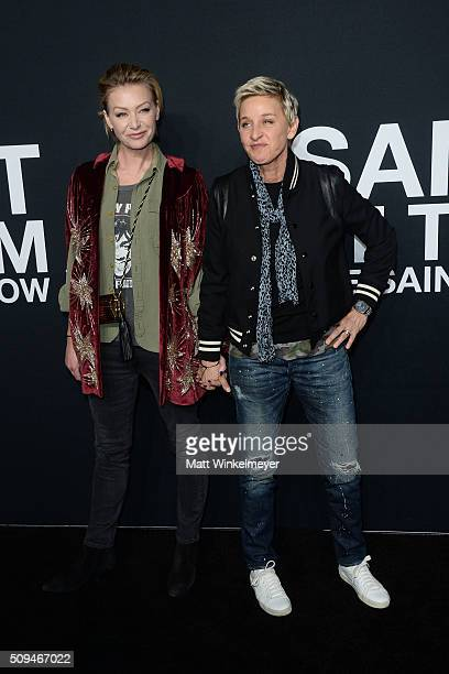 Actress Portia de Rossi in Saint Laurent by Hedi Slimane and TV Personality Ellen DeGeneres arrive at the Saint Laurent show at the Hollywood...
