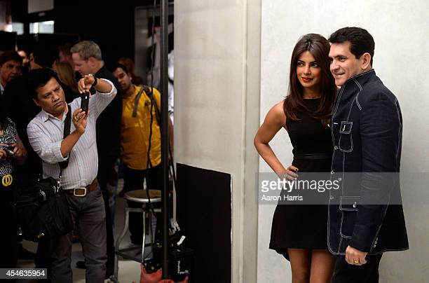 Actress Priyanka Chopra and director Omung Kumar pose at the Guess Portrait Studio during 2014 Toronto International Film Festival on September 4...