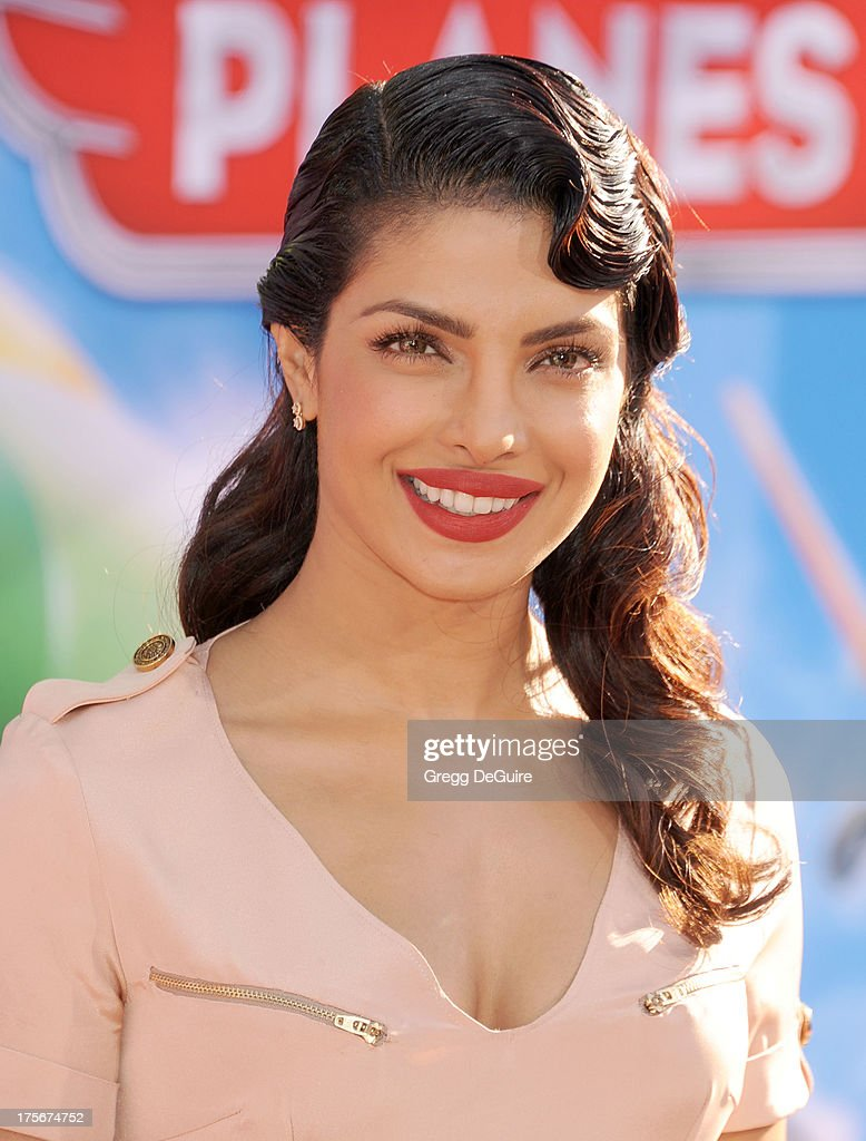 Actress Priyanka Chopra arrives at the Los Angeles premiere of 'Planes' at the El Capitan Theatre on August 5 2013 in Hollywood California