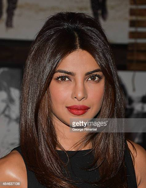 Actress Priyanka Chopra attends the Guess Portrait Studio during the 2014 Toronto International Film Festival at TIFF Bell Lightbox on September 4...