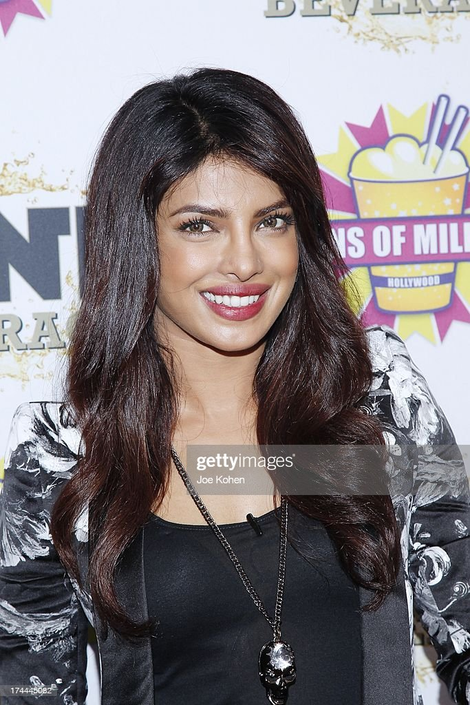Actress <a gi-track='captionPersonalityLinkClicked' href=/galleries/search?phrase=Priyanka+Chopra&family=editorial&specificpeople=228954 ng-click='$event.stopPropagation()'>Priyanka Chopra</a> Launches Her celebrity milkshake, 'The Exotic' which includebananas, almonds and caramel sauce with a vanila ice cream and a splash of Mr. Pink ginsang drink At Millions Of Milkshakes at Millions Of Milkshakes on July 25, 2013 in West Hollywood, California.