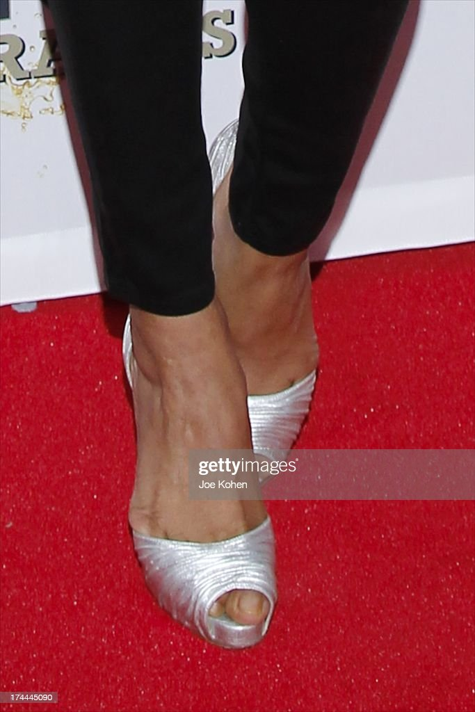 Actress Priyanka Chopra (shoe detail) Launches Her celebrity milkshake, 'The Exotic' which includebananas, almonds and caramel sauce with a vanila ice cream and a splash of Mr. Pink ginsang drink At Millions Of Milkshakes at Millions Of Milkshakes on July 25, 2013 in West Hollywood, California.