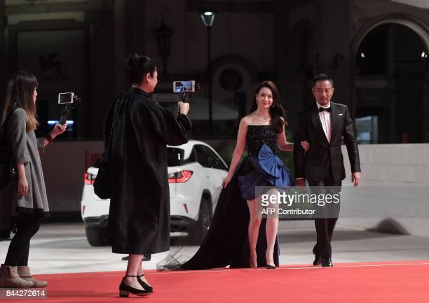 Actress Qi Wei and actor Zhang Hanyu attend the premiere of the movie 'Zhuibu' presented out of competition at the 74th Venice Film Festival on...