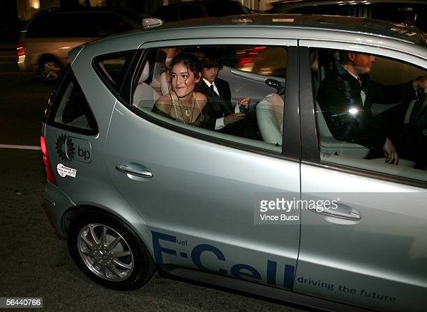 Actress Q'Orianka Kilcher and her brother Kainoa Kilcher arrive in the Fuel Cell car at the New Line Cinema premiere of 'The New World' presented by...