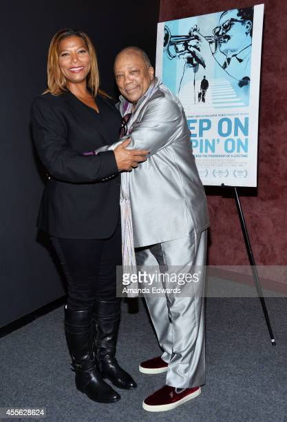 Actress Queen Latifah and producer Quincy Jones arrive at the Los Angeles premiere of 'Keep On Keepin' On' at the Landmark Theatre on September 17...