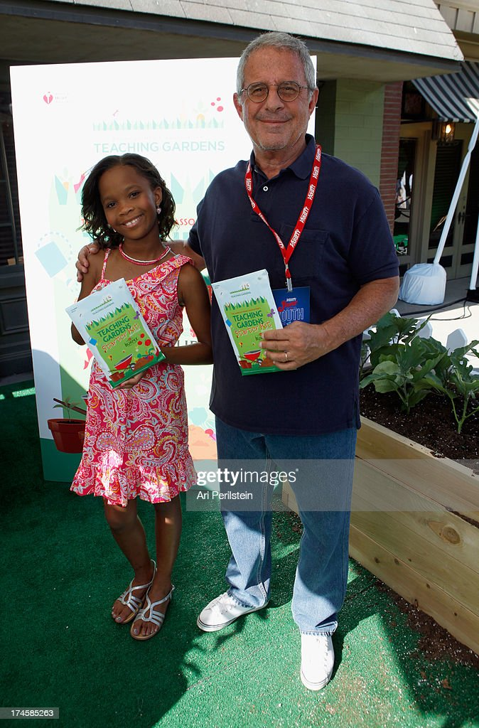 Actress Quvenzhane Wallis (L) and Universal Studios Chief Operating Officer <a gi-track='captionPersonalityLinkClicked' href=/galleries/search?phrase=Ron+Meyer&family=editorial&specificpeople=213476 ng-click='$event.stopPropagation()'>Ron Meyer</a> attend Variety's Power of Youth presented by Hasbro, Inc. and generationOn at Universal Studios Backlot on July 27, 2013 in Universal City, California.