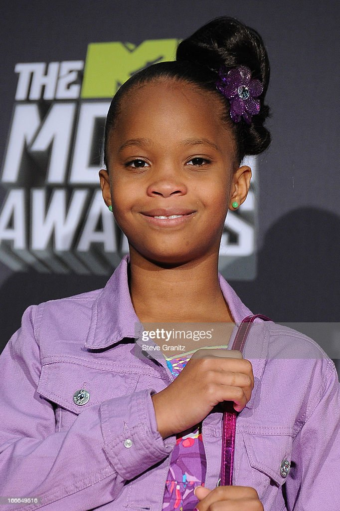 Actress Quvenzhane Wallis poses in the press room during the 2013 MTV Movie Awards at Sony Pictures Studios on April 14, 2013 in Culver City, California.