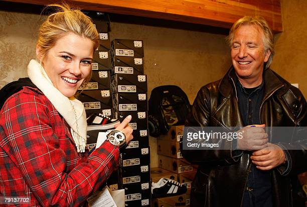 Actress Rachael Taylor and actor Alan Rickman pose with the Curtis Co watch company and Osiris shoe display at the Gibson Guitar celebrity...