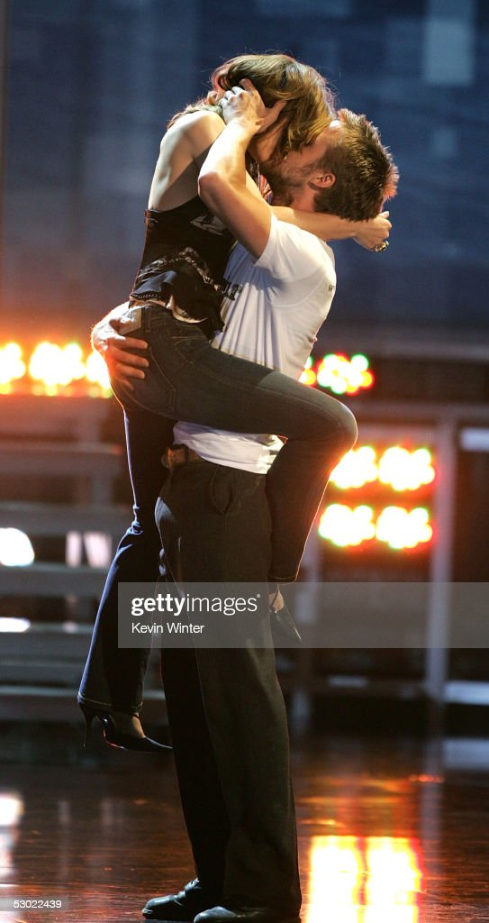Actress Rachel McAdams (left) and Actor Ryan Gosling accept the award for Best Kiss for The Notebook onstage during the 2005 MTV Movie Awards at the Shrine Auditorium on June 4, 2005 in Los Angeles, California. The 14th annual award show will premiere on MTV Thursday, June 9 at 9:00PM (ET/PT).