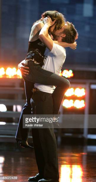 Actress Rachel McAdams and Actor Ryan Gosling accept the award for Best Kiss for The Notebook onstage during the 2005 MTV Movie Awards at the Shrine...