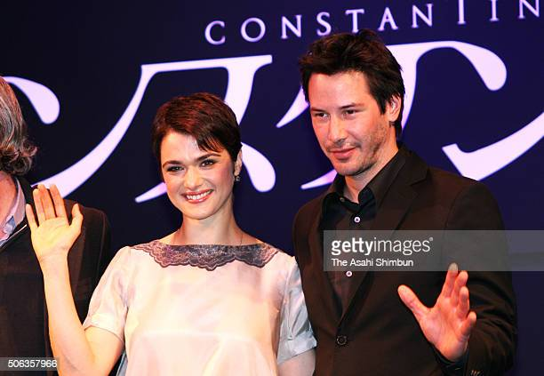 Actress Rachel Weisz and actor Keanu Reeves wave during the 'Constantine' press conference on April 12 2005 in Tokyo Japan