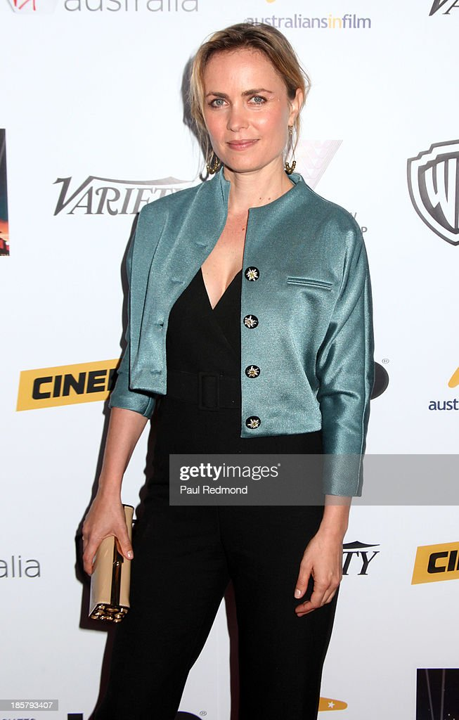 Actress <a gi-track='captionPersonalityLinkClicked' href=/galleries/search?phrase=Radha+Mitchell&family=editorial&specificpeople=204168 ng-click='$event.stopPropagation()'>Radha Mitchell</a> arrives at the Australians In Film Benefit Dinner at the InterContinental Hotel on October 24, 2013 in Century City, California.