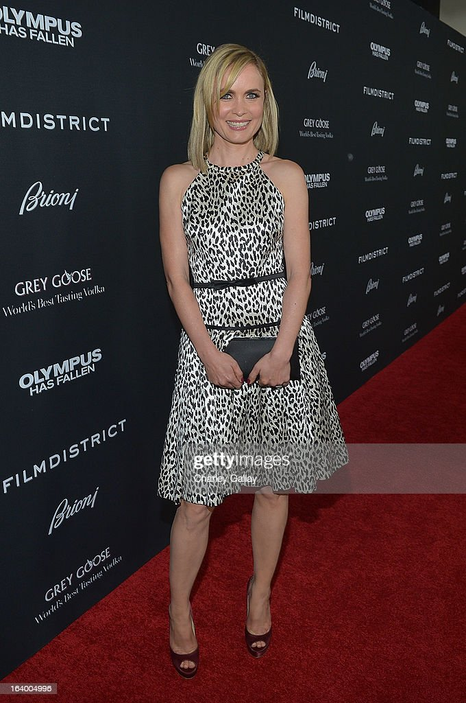 Actress Radha Mitchell attends Brioni Sponsors Film District's World Premiere Of 'Olympus Has Fallen' ArcLight Cinemas on March 18, 2013 in Hollywood, California.