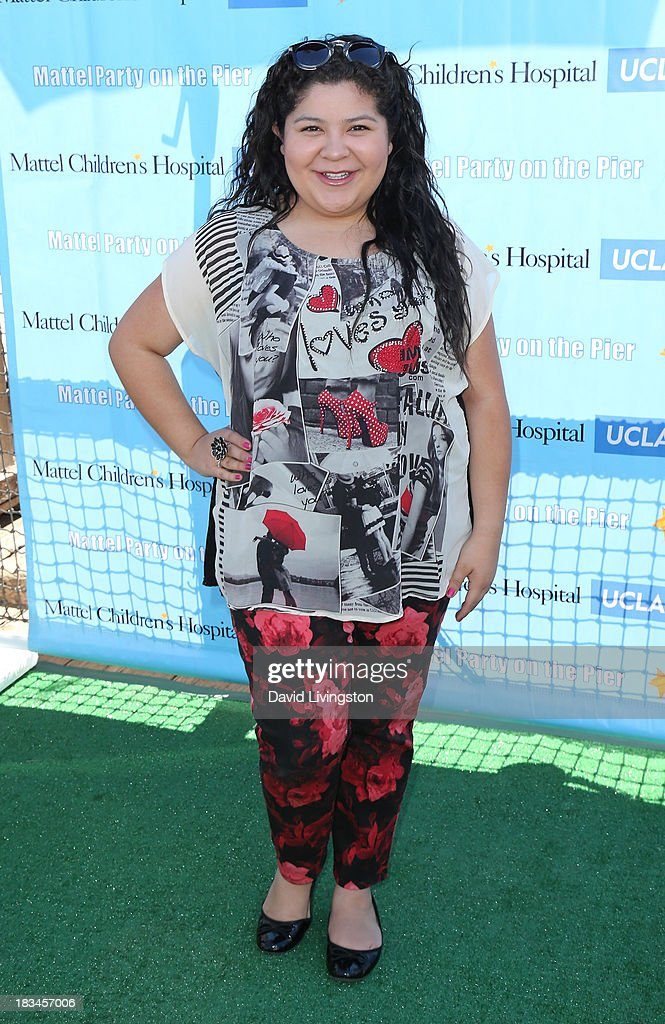 Actress <a gi-track='captionPersonalityLinkClicked' href=/galleries/search?phrase=Raini+Rodriguez&family=editorial&specificpeople=5659055 ng-click='$event.stopPropagation()'>Raini Rodriguez</a> attends the 14th annual Mattel Party on the Pier benefiting Mattel Children's Hospital UCLA at Pacific Park on the Santa Monica Pier on October 6, 2013 in Santa Monica, California.